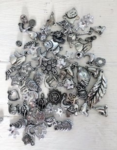 An Exciting Assorment of Silver Acrylic Charms, great for kids and parties +/ 80 grams