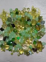 An Exciting Assortment of Acrylic Green Beads in different shapes and sizes, always a winner