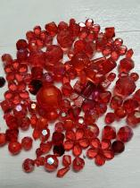 An Exciting Assortment of Acrylic Red Beads in different shapes and sizes, always a winner